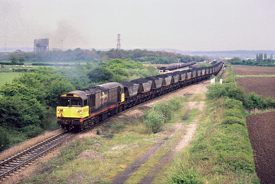 A workstained 58033 passes Warsop Up Sdgs near Shirebrook on 10/05/1988 with a trainload of coal from the Nottinghamshire coalfield bound for either Cottam or West Burton power stations.