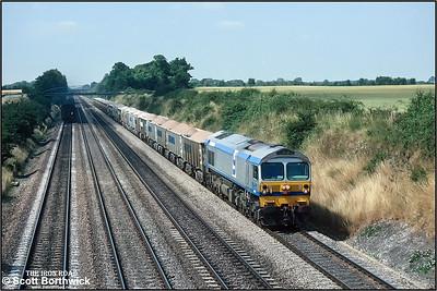 59004 passes Shottesbrooke Farm whilst working 7L40 0740 MSX Merehead Quarry-Purfleet on 24/07/1990.