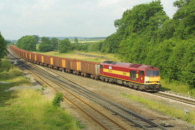 60048 approaches Brocklesby with a Santon-Immingham iron ore empties on 20/07/2002.