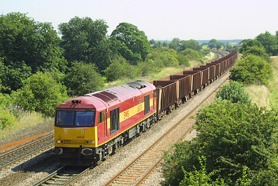 60038 rumbles through Melton Ross with 6T24 1116 Immingham Ore Terminal-Santon on 26/07/2003 with iron ore for the steelworks at Scunthorpe.