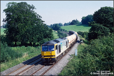 60024 'Elizabeth Fry' passes Sherrington whilst working 6V13 1218 Furzebrook Oil Sdgs-Hallen Marsh LPG Sdgs on 31/07/1992.