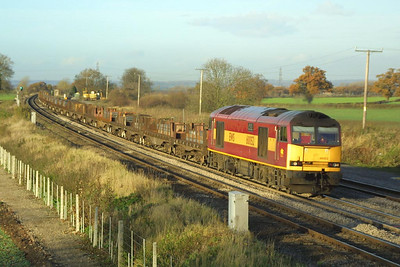 60052 passes Elford on 26/11/2001 with a southbound train of steel slabs.