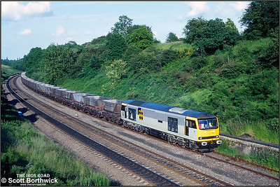 An immaculate 60057 'Adam Smith' ambles along the loop whilst climbing Hatton bank working 6E05 1745 Didcot Power Station-Barrow Hill SS on 01/07/1991.