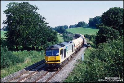 60024 'Elizabeth Fry' passes Sherrington whilst working 6V13 1218 Furzebrook Oil Sdgs-Hallen Marsh LPG Sdgs on 31/07/1992.