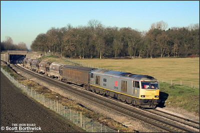 Production in the Potteries was obviously slow judging by the small number of china clay empties conveyed on 6V70 0858 Cliff Vale-St Blazey SS headed by 60006 passing Besford on 12/12/2001.