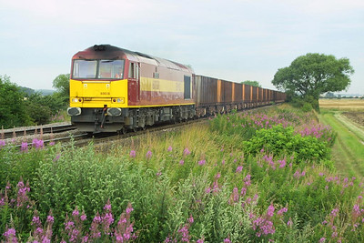 60038 is pictured at Elsham Carrs with iron ore etys on 26/07/2002 whilst working 6K22 0920 Santon-Immingham Ore Terminal.