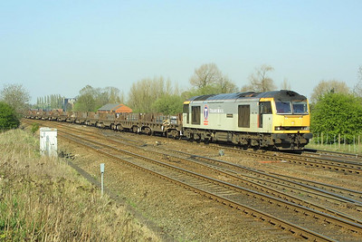60063 is pictured at Milford Junction on 17/04/2003 in charge of 6V37 1259 Lackenby-Llanwern steel slabs.
