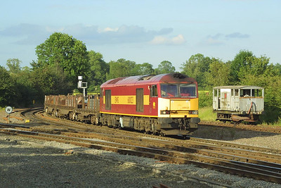60023 is pictured rounding the curve at Whitacre Junction on 07/07/2002 with 6V42 0958 Lackenby-Llanwern steel slab.
