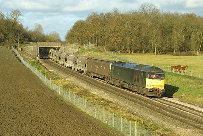 60081 powers 6V70 1000 Cliff Vale-St Blazey SS china clay empties at Besford on 05/12/2001.