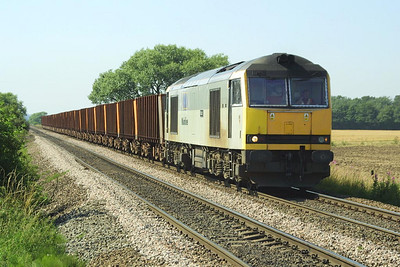60087 is seen returning from Scunthorpe at Elsham Carrs on 26/07/2002 with 6K25 1516 Santon-Immingham Ore Terminal.
