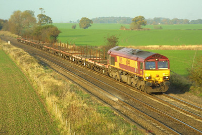66044 heads south at Portway on 19/11/2001 with a rake of BDA steel etys.