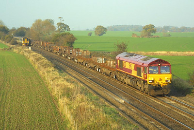 66202 heads south at Portway on 19/11/2001 with a train of steel slab.