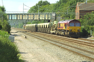 66184 & 66137 top & tail a Redland self discharge train at Cathiron on 13/07/2002.