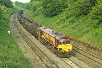 66044 on the 'sticky tanks' is pictured climbing Hatton bank on 16/06/2003 whilst working 6M23 1402 MThO Fawley-Washwood Heath bitumen tanks.