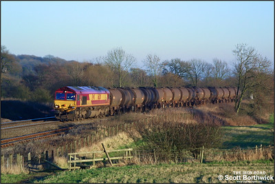 Running almost three hours late, 66201 climbs Hatton bank with a retimed & diverted 6E33 Baglan Bay-Hull Saltend empty acetic acid tanks on 31/12/2001.