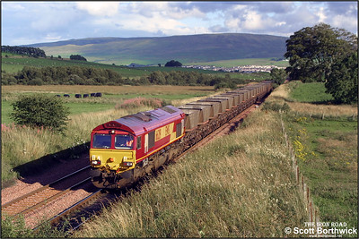 66219 heads an unidentified train of empty HAA's north for reloading in the Ayrshire coalfields at Polquap on 16/08/2001.