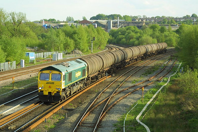 The evening shadows are lengthening as 66609 passes Clay Cross South Jnct on 08/05/2003 with the Mondays and Fridays 'as required' 6Z76 1600 Sinfin-Lindsey Oil Refinery.