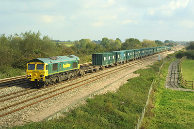 66527 is pictured at Denchworth on 18/10/2002 whilst working 4V60 1055 Calvert-Bristol Barrow Road refuse empties.