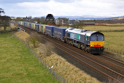 66404 passes Forteviot on 04/03/2005 whilst working 4A11 1038 Grangemouth-Aberdeen Guild Street  'Malcolm/ASDA' Intermodal service.