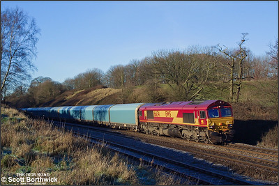 66134 descends Hatton bank working a very late 4O20 0446 Washwood Heath-Southampton Eastern Docks conveying Rover cars for export on 31/12/2001.