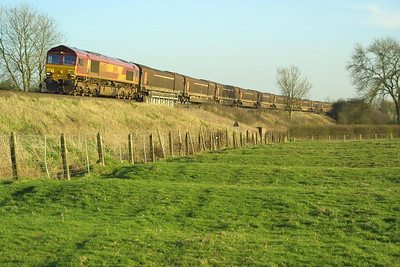 66057 is pictured approaching Bishops Itchington, Warwickshire on 27/03/2002 whilst in charge of 4M08 1412 Swindon Rover Group-Longbridge East conveying car body panels.