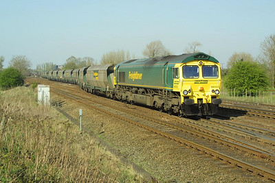 66553 heads 6G09 1415 Immingham-Ferrybridge Power Station past Milford Junction on 17/04/2003.