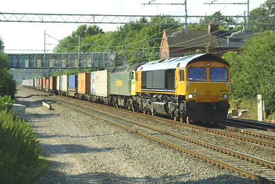 Fresh out of Glasgow works after a repaint, 66709 pilots 57003 as it passes Cathiron on 13/07/2002 whilst in charge of a diverted 4O29 1238 Trafford Park-Southampton MCT. The train was diverted via the WCML due to engineering work between Banbury & Oxford. 66709 piloted the 57 from Crewe Basford Hall as far as Willesden in order to get the loco to Willesden TMD where the finishing touches to the livery would be applied, which can be seen later on in this collection.