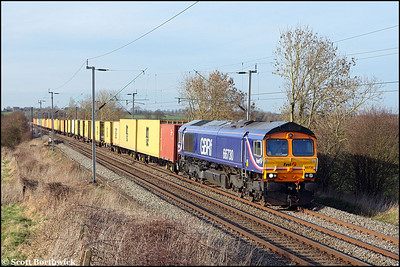 66730 passes Long Buckby with 4L22 1516 Hams Hall-Felixstowe North on 16/03/2009.