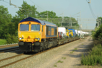 On hire to Freightliner Heavy Haul, GBRF owned 66716 is pictured passing Cathiron on Friday 13th June 2003 in charge of 4M26 1421 SX Dagenham-Crewe Gresty Road.
