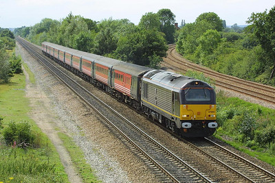 Royal Train liveried 67005 attempts to make up time as it speeds past North Stafford Jnct on 24/07/2004 with 1E99 0905 SO Paignton-Newcastle. The train had been held for thirty minutes at Bristol Temple Meads awaiting the arrival of 1E32 0802 Penzance-Newcastle in order that passengers could transfer trains due to 1E32 (a four car voyager)  being 'full and standing'. Oh for the mass re-intoduction  of proper trains !!!!