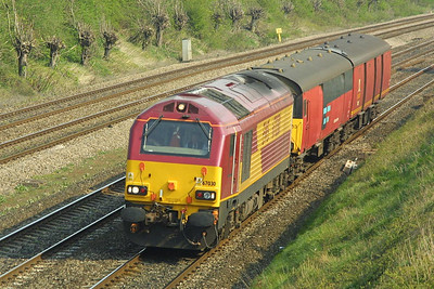 67030 is pictured on the Down Main in South Moreton Cutting on 10/04/2002 whilst working 5C37 1355 WO Old Oak Common-Bristol Barton Hill. The train conveyed mail vans returning to traffic after repair at Old Oak Common T&RSMD.