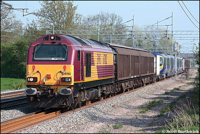 67012 passes Cathiron on 10/05/2006 with 6X16 1431 Wembley EFOC-Longsight TMD delivering 185115 from Siemens Transportation, Germany.