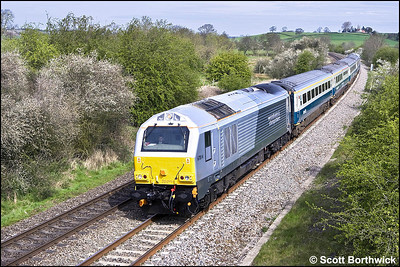 67014 top & tails 67012 at Holmes House Farm, Bishops Itchington with 1Z76 0815 Wrexham General-London Marylebone on 26/04/2008. The train was a special for Wrexham Shropshire & Marylebone Railway staff and their families prior to the commencement of regular timetabled services.