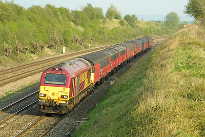 67028 speeds along the Down Main in South Moreton Cutting with 1V33 1558 Willesden PRDC-Plymouth mails on 10/04/2002.