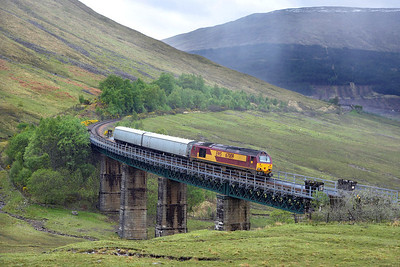 67009 crosses the southern viaduct in the Horse Shoe Curve during yet another torrential downpour on 25/06/2006 whilst working 5Z06 0647 Mossend Yard-Rannoch driver training in readiness of the class taking over from class 37's on the sleepers in June.