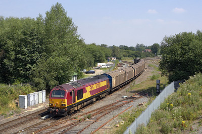 67001 hauls 6G42 1123 Birch Coppice-Bescot Yard through Whitacre Junction on 25/07/2006.