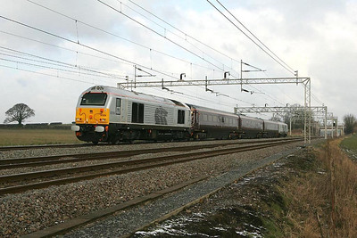 67029 passes Dordon Hall Farm on 22/02/2005 working 1Z05 0823 London Euston-Lichfield Trent Valley.