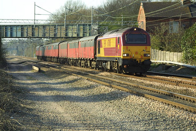 Diagrammed for an EWS 90, 67008 made an unusual appearance at the head of 1A90 1532 SX Warrington RMT-Willesden PRDC when pictured at Cathiron on Tuesday 8th April 2003.