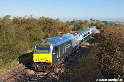 67010 dodges the shadows at an autumnal Holmes House Farm, Bishops Itchington whilst in charge of 1P03 0723 Wrexham General-London Marylebone on 08/10/2009.