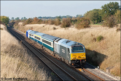 67010 passes Fritwell running around 20 minutes late with 1P13 1127 Wrexham General-London Marylebone on 14/10/2009.