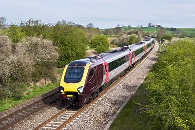 220017 passes Holmes House Farm, Bishops Itchington whilst forming 1O09 0933 Birmingham New Street-Brighton on 26/04/2008.