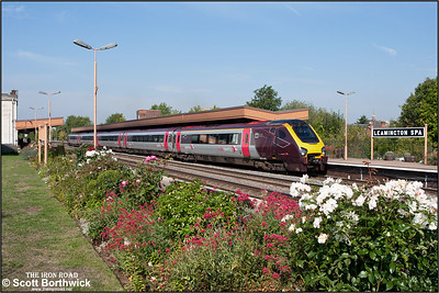 221128 restarts 1O10 0827 Manchester Piccadilly-Bournemouth away from Leamington Spa on 02/09/2011.
