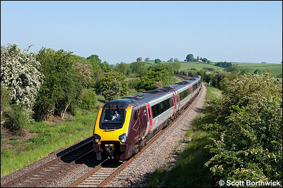 With GG at the controls, 221131 passes Holmes House Farm, Bishops Itchington whilst forming 1O08 0726 Manchester Piccadilly-Bournemouth on a glorious 03/06/2010.
