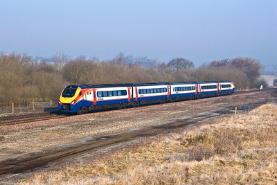 The first, and at the time, only Class 222 to wear the East Midlands Trains livery, 222017 passes Finedon Sdgs on 18/02/2008 forming 1P11 0710 Burton upon Trent-London St Pancras International.