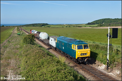 D7076 is checked at Weybourne's home signal with a short mixed freight on 11/06/2015. (Photo taken with camera mounted on a pole & remotely triggered)