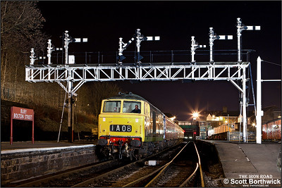 D7076 passes under the impressive signal gantry at Bury Bolton Street on 16/02/2013.