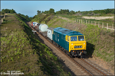 D7076 passes Kelling Heath cutting with a short mixed freight on 11/06/2015. (Photo taken with camera mounted on a pole & remotely triggered)