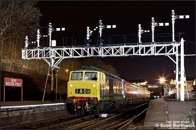 D7076 passes under the impressive signal gantry at Bury Bolton Street on 16/02/2013.