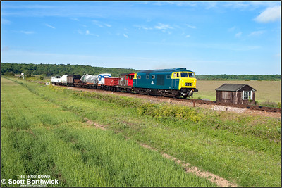 D7076 accelerates away from Weybourne with a short mixed freight on 11/06/2015. (Photo taken with camera mounted on a pole & remotely triggered)