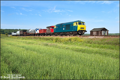 D7076 accelerates away from Weybourne with a short mixed freight on 11/06/2015.